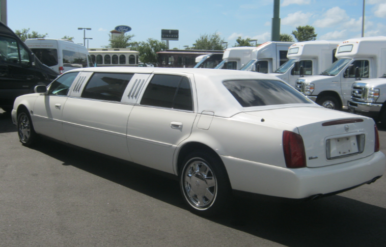 Photo of 6 Passenger White Cadillac Stretch Limousine preparing for a funeral in Clearwater, Florida.