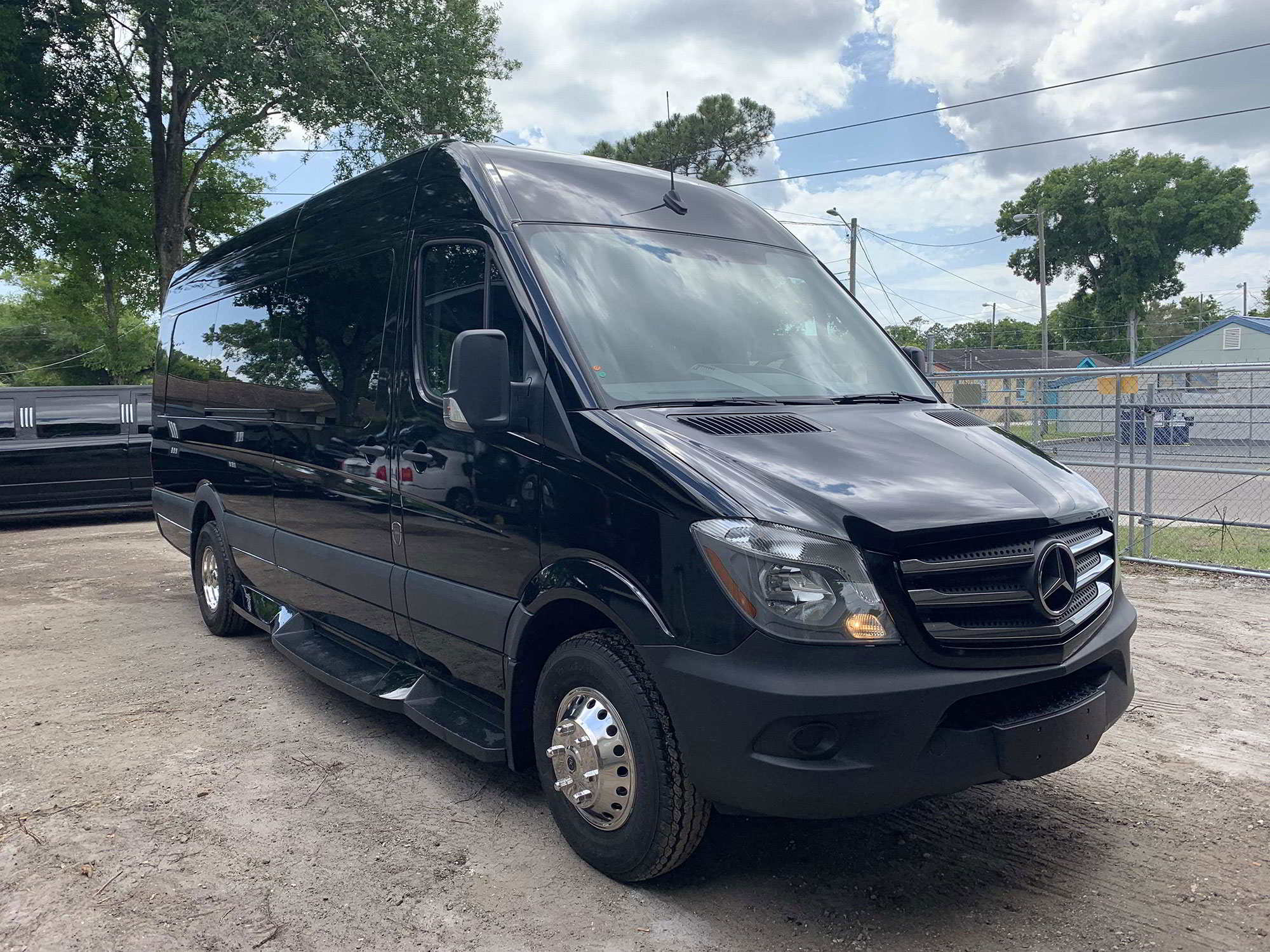 Photo of a 12 Passenger Black Mercedes Benz Sprinter Van, Graduation Clearwater High School, Clearwater, Florida.